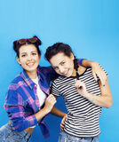 Best friends teenage school girls together having fun, posing emotional on blue background, besties happy smiling. Lifestyle people concept close up Stock Photos