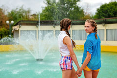 Best friends teens holding hands. Royalty Free Stock Images