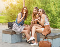 The best friends. Three beautiful woman eating ice cream in the City Royalty Free Stock Image