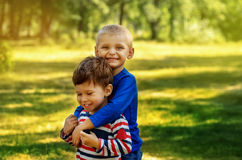 Best friends. Two friend boys hugging and having fun in summer park Royalty Free Stock Images