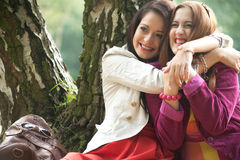 2 best friends. Two girls are having a lot of fun in the forest stock photography
