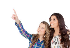 The best friends. Two pretty women indicating something Royalty Free Stock Photo