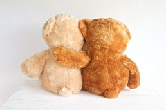 Best friends. Two teddy bears with arms around each other Stock Photo