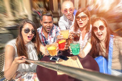 Best friends using selfie stick taking pic sitting at restaurant. Best friends using selfie stick taking pic sitting at cocktail restaurant bar - Concept of royalty free stock images