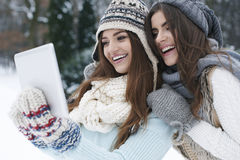 Best friends using tablet Royalty Free Stock Photo