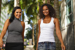 Best friends walking and smiling Stock Photography