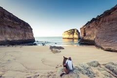 Best friends wanderlust watching sunrise at beach Stock Photo