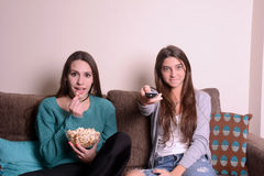 Best friends watching a movie Stock Photo