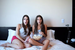 Best friends watching tv or a movie in bed Stock Photography
