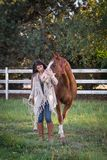 Best Friends. A woman`s close friendship with her horse royalty free stock image
