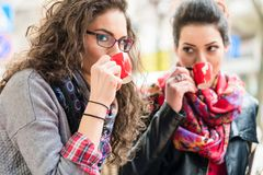 Girl friends drinking coffee together in cafe. Best friends women drinking coffee together in street cafe Stock Photo