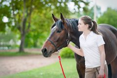 Best friends. Young teenage girl together with her chestnut horse royalty free stock photo