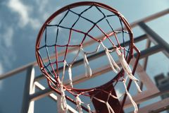 Best game ever. Shot of basketball hoop with sky in the background outdoors royalty free stock photography