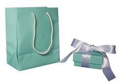 The Best Gift of All!. A little blue bag with matching gift box and satin ribbon Royalty Free Stock Images