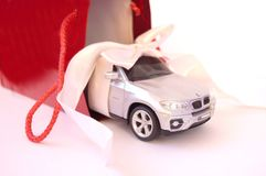 Modern, fashionable car on a white background, money. Symbol of success royalty free stock photography