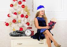 Best gift ever. Excitement replaced with strong feeling satisfaction. Little girl santa hat satisfied christmas gift. Happy new year concept. Kid sit near stock image