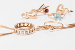 Best gift for girl - gold jewelry Stock Photos