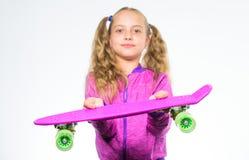 Best gift for kid. Kid long hair carry penny board. Plastic skateboards for everyday skater. Child hold penny board. Penny board of her dream. Choose stock photo