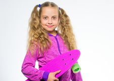 Best gifts for kids. Ultimate gift list help pick perfect present for girl. Child hold penny board. Kid long hair carry. Penny board. Plastic skateboards for stock images