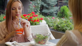 With best girlfriend. Women on the terrace of a cozy cafe rejoices meeting stock footage