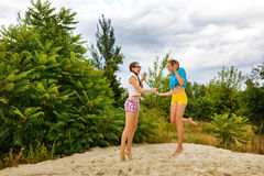 Best girlfriends have fun in the sand. Royalty Free Stock Image