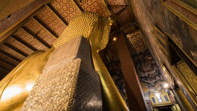 The Best of the Golden Giant Reclining Buddha in Wat Pho Buddhist Temple, Bangkok, Thailand Stock Photo