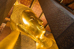 The Best of the Golden Giant Reclining Buddha in Wat Pho Buddhist Temple, Bangkok, Thailand. The Golden Giant Reclining Buddha (Sleep Buddha) in Wat Pho Buddhist royalty free stock photo