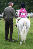 Best Grandad. Grandad leads his grandaughter in the lead rein pony games at our local show.Years before  he did the same for his daughter and now he delights in Royalty Free Stock Images