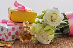 Best greetings for the beloved woman or girl flowers and a souvenir or surprise Stock Photography