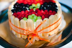 Best home made birthday cake - fresh berries, sweet rusk. royalty free stock photography