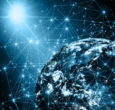 Best Internet Concept of global business from concepts series. Planet earth and rays on a blue background, symbolizing the data line on the Internet. Internet Royalty Free Stock Photo
