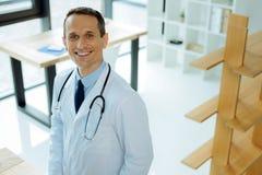 Joyful smart doctor being ready to work Stock Photo
