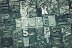 Best kept secret. Crossword concept made from metallic letterpress blocks on letters background stock photography