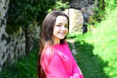 Best look of long hair. Pretty girl with natural straight hairstyle on spring day. Girl child with healthy brunette hair. Cute girl with long hairstyle on royalty free stock image