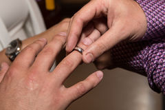 Best man put a ring on grooms finger in wedding ceremony in orthodox church. Belgrade Royalty Free Stock Photography