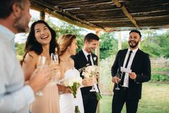 Best man speech for newlywed couple. Best men giving speech to newlywed couple at wedding reception. Group of friends gathering for wedding reception stock photography