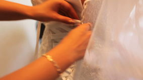 The best man tying white bride.  stock video footage