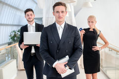 Best Manager. Young man in formal wear holding a the tablet and Stock Image