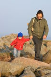 Best mates - father and son. Father and son walking on the mole at spring time Stock Photography