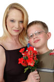 Best Mom. Mom and son stand holding flowers Stock Photo