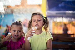 Best moment in the summer. Two little girl eating ice cream together in park. Close up. Space for copy royalty free stock photos