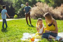 Devoted parents playing with their kids outdoors Stock Photo