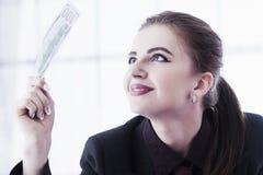 Best motivation is money.I love money!  Happy businesswoman work Stock Image