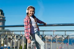 Best music apps that deserve a listen. Make your kid happy with best rated kids headphones available right now. Girl. Child listen music outdoors with modern stock image