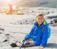 Cute boy with hiking equipment in the mountains Royalty Free Stock Photography
