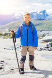Cute boy with hiking equipment in the mountains Stock Images