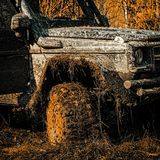 Best Off Road Vehicles. Track on mud. 4x4 Off-road suv car. Safari suv. Safari. Bottom view to big offroad car wheel on stock photography