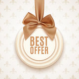 Best offer badge with golden ribbon and a bow Royalty Free Stock Images