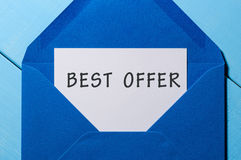 Best offer inscription at letter in blue envelope. Sale concept.  Royalty Free Stock Images