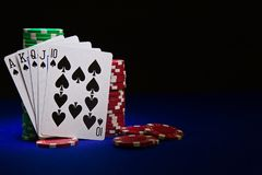 Royal flush with stuck of chips Stock Photo